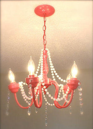 Recycled pink nursery chandelier that was painted pink for a baby girl princess theme nursery ceiling