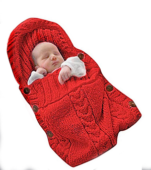 Soft baby blanket made from black and white damask fabric with red binding