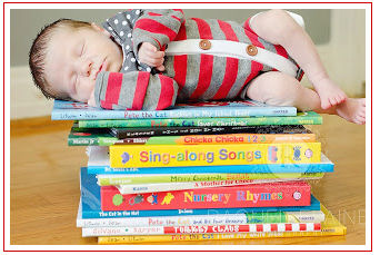 Newborn baby boy picture ideas with books and nursery rhymes