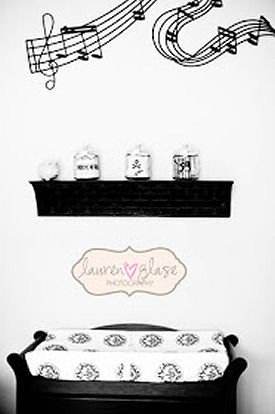 Musical wall decal over the baby changing area of a nursery room