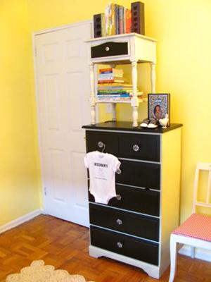 I painted the vintage nursery dresser in black and white and then updated the drawer pulls.  It looks amazing with the baby's yellow nursery walls.