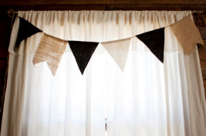 Homemade rustic muslin rod pocket nursery curtains made from a tablecloth
