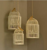 Rustic bamboo bird cages made of distressed wood make unique baby nursery ceiling mobiles