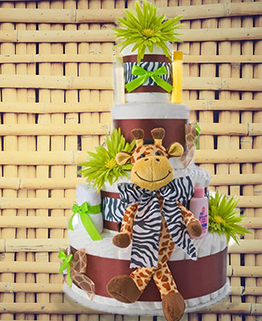 Jungle safari baby shower diaper cake centerpiece for a girl in pink and zebra print with toy giraffe decorations