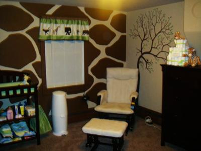 The baby's green, brown, white, and tan safari crib bedding set determined the color scheme and theme for the room.