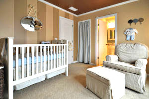 Painted wall stripes in a baby boy nursery in shades of brown