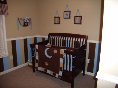 Chocolate brown and blue baby boy nursery room decorated in a moon stars and stripes theme