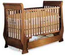 Wooden baby sleigh crib woodworking plans with drawer underneath the baby bed