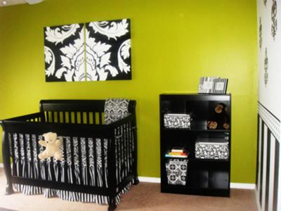 Elegant nursery decorated in black and white damask with green accents for a baby girl