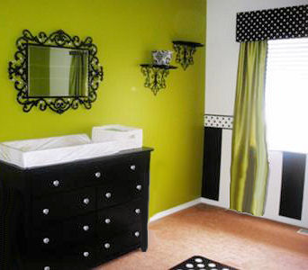 Black and white stripes painted with a polka dot border in a baby girl nursery