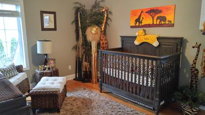 The baby's crib in our jungle baby nursery theme