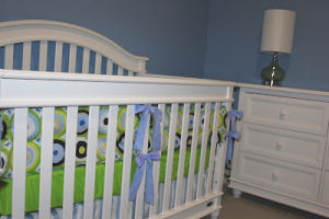 Modern lime green navy baby blue and white custom made baby crib bedding for a baby boy nursery room