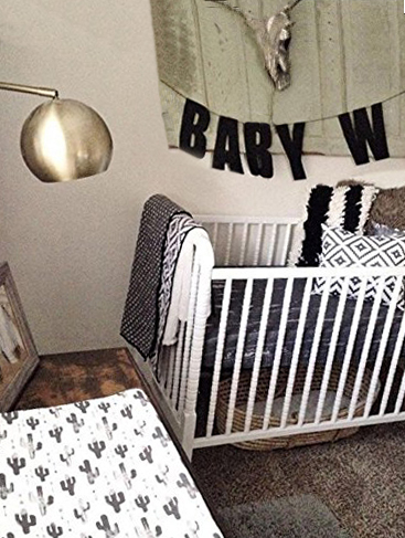 Gender neutral southwest cactus baby nursery ideas with black cactus and western desert accessories and crib bedding for a boy or girl