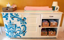 Baby changer dresser painted using a large damask stencil pattern