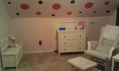 Hot pink and chocolate brown wall decals on the sloped part of the nursery ceiling.