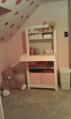 This pretty pink and white piece of nursery furniture makes organizing baby's items easy!