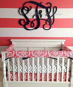 Baby Girl nursery room with hot pink watermelon stripes on the wall and chevron baby crib bedding set