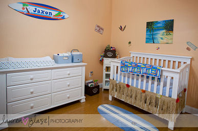 Surf nursery theme with personalized surfboard wall decals baby blue bedding and raffia crib skirt