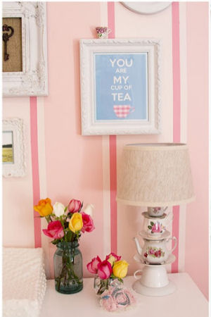 Vintage style topsy turvy stacked teacups and saucers lamp in a pretty pink teacup theme baby girl nursery room