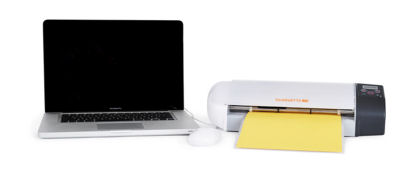 The Silhouette SD Cutting Machine Attached to a Laptop Computer