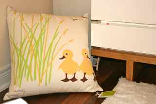 The yellow ducky pillow that was the perfect inspiration piece for my baby's tranquil modern nursery design.