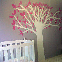 White painted tree with pink leaves on the wall of a baby girl nursery