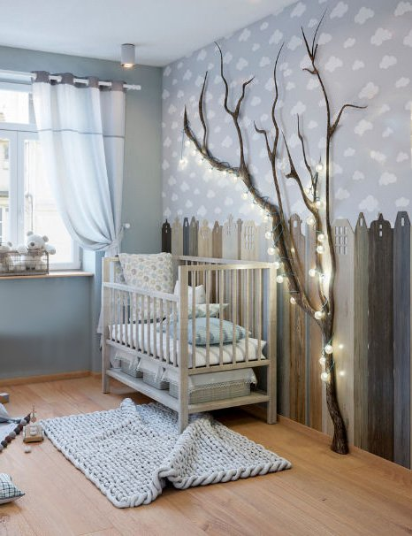 Cloud themed baby room for a boy with a 3d tree and cityscape wall mural