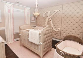 Baby girl nursery with a tufted stencil design on the walls