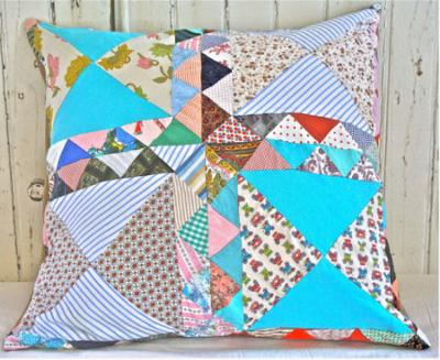 Vintage heirloom patchwork quilt pillows are perfect for a nursery rocking chair in an old-fashioned baby nursery.