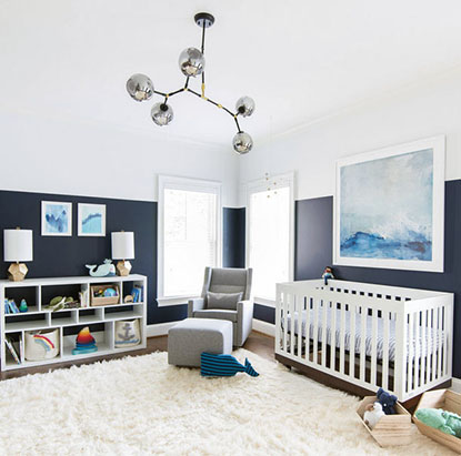 Contemporary modern baby boy whale nursery theme in navy blue and white