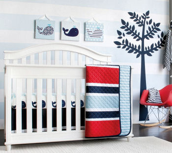 Baby boy whale nursery décor with blue whales white crib and baby blue and white wall painting technique