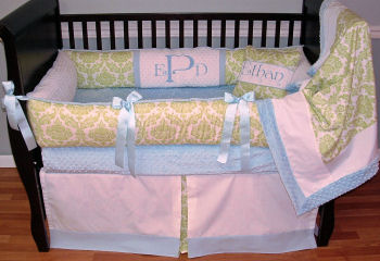 This Modpeapod custom baby bedding is the perfect inspiration for a white and lime green nursery for a baby boy.