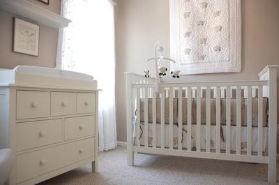 Our baby girl's white heirloom nursery decor includes a Pottery Barn Kids Kendall crib and dresser with clean lines.