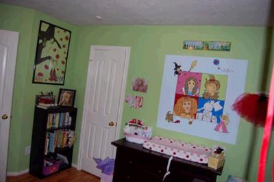 Another Wizard of Oz mural over the changing table featuring the main characters  and a view of the rest of  the nursery.