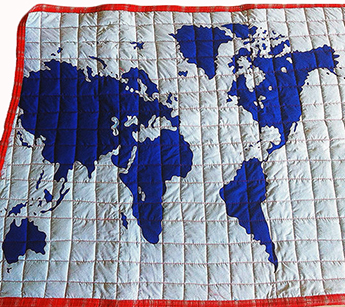 Baby crib quilt with world map applique pattern quilted squares