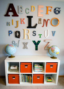 Orange fabric bins used as baby nursery storage containers