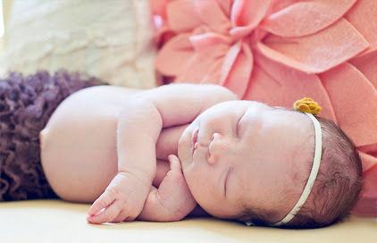 Precious newborn baby girl photo
