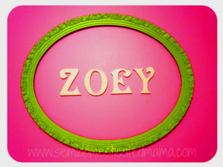 Bright lime green painted oval framed wooden wall letters look cool with the hot pink paint color of this baby girl nursery